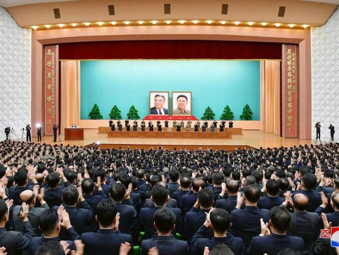 Officials at a ceremony to celebrate North Korea's 70th anniversary  North Korea to hold military parade as regime celebrates 70th anniversary skynews north korea 70th anniversary 4415310