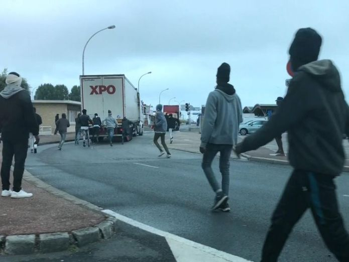 Ouistreham  Migrants' desperate dash to catch lorries to the UK skynews ouistreham stone migrants 4413433