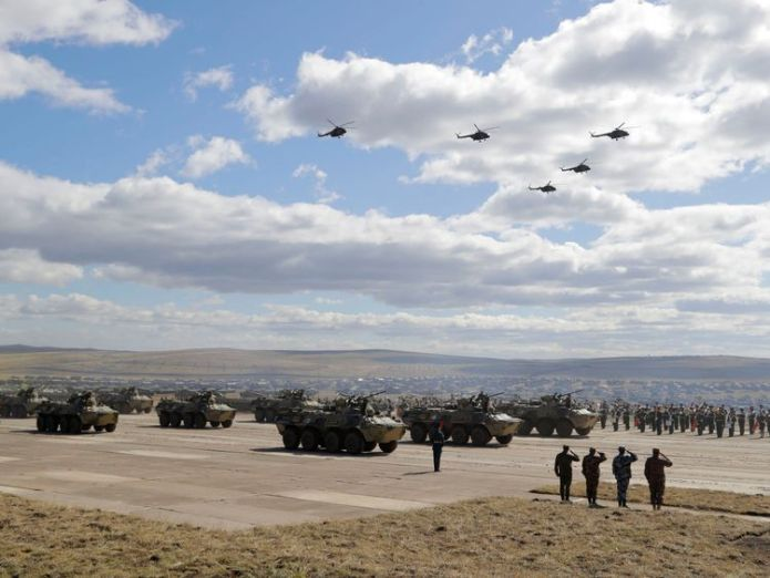 """Military vehicles and helicopters in motion during a parade on training ground """"Telemba""""  Russia's war games 'horrifying and awe-inspiring' skynews russia war games 4419425"""