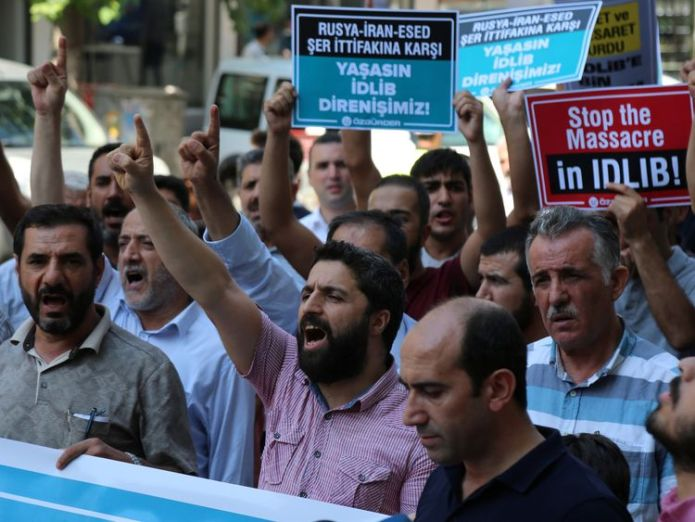People in Diyarbakir, Turkey, protest against the Syrian government's military operation in Idlib  'Great fear' as Syrian regime bombs edge of rebels' last stronghold Idlib skynews turkey syria idlib 4415073