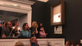 Banksy has apparently shed some light on the shredding of his painting at an auction