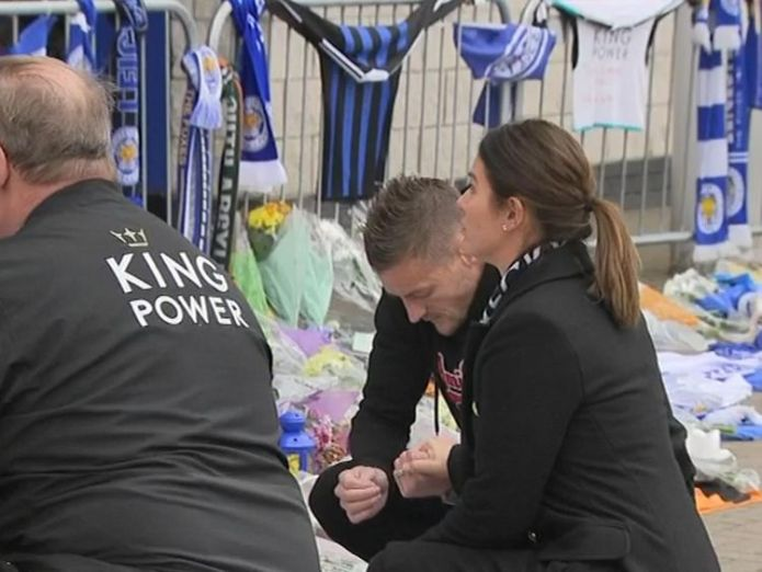 Jamie Vardy puts flowers in front of the King Power Stadium