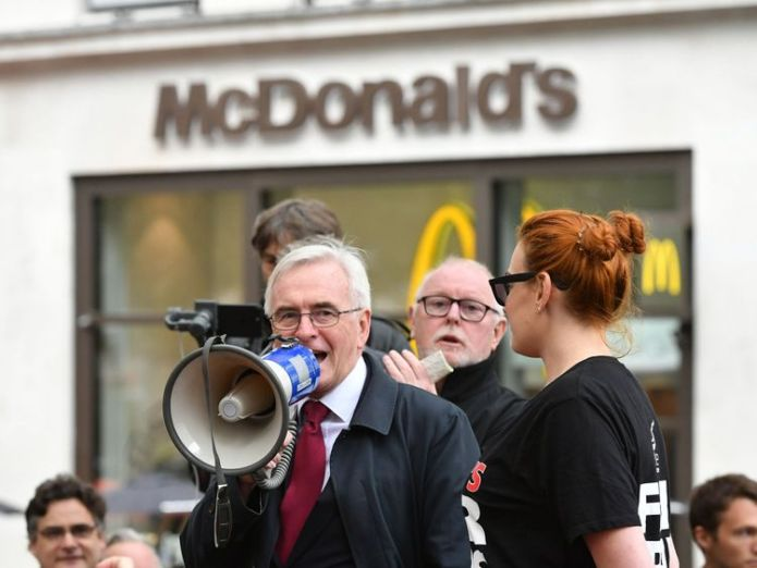 Shadow chancellor John McDonnell speaking at a rally about disputes over pay and union recognition in Leicester Square, London.   Hospitality workers protest over pay and conditions skynews john mcdonnell hospitality 4442919