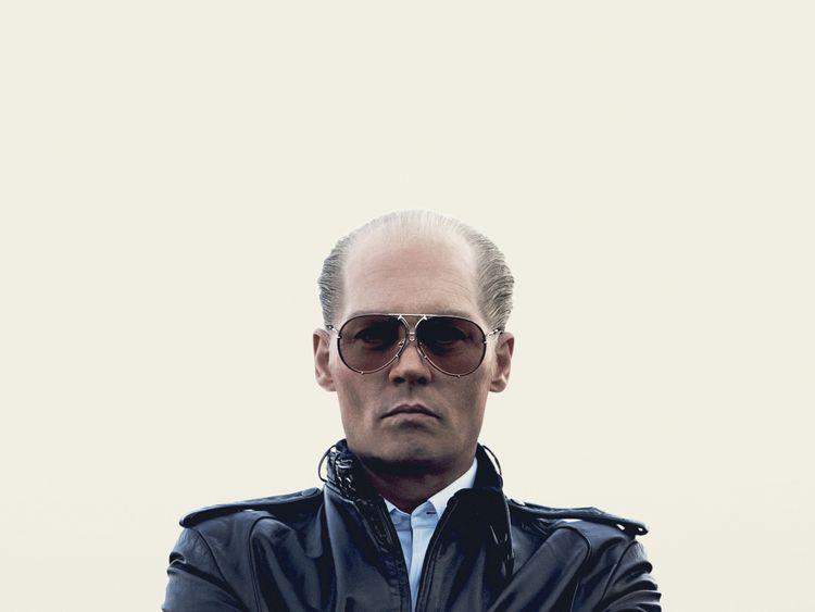 Johnny Depp as the Boston mob boss Whitey Bulger