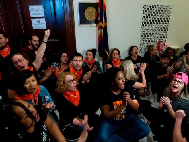 Protesters against US Supreme Court nominee Brett Kavanaugh block the office of US Senator Jeff Flakes