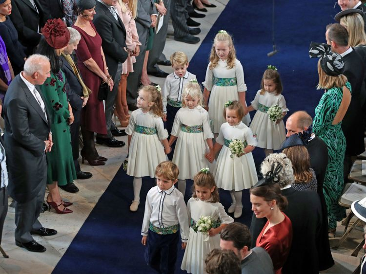 Bridesmaid Princess Charlotte (right) and Lady Louise Mountbatten-Windsor arrives for the wedding of Princess Eugenie to Jack Brooksbank at St George's Chapel in Windsor Castle, Britain October 12, 2018. Aaron Chown/Pool via REUTERS