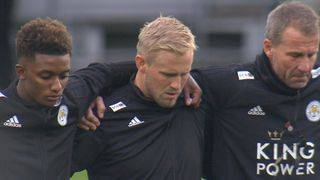 Kasper Schmeichel sheds a tear during a minutes silence for Leicester City owner.