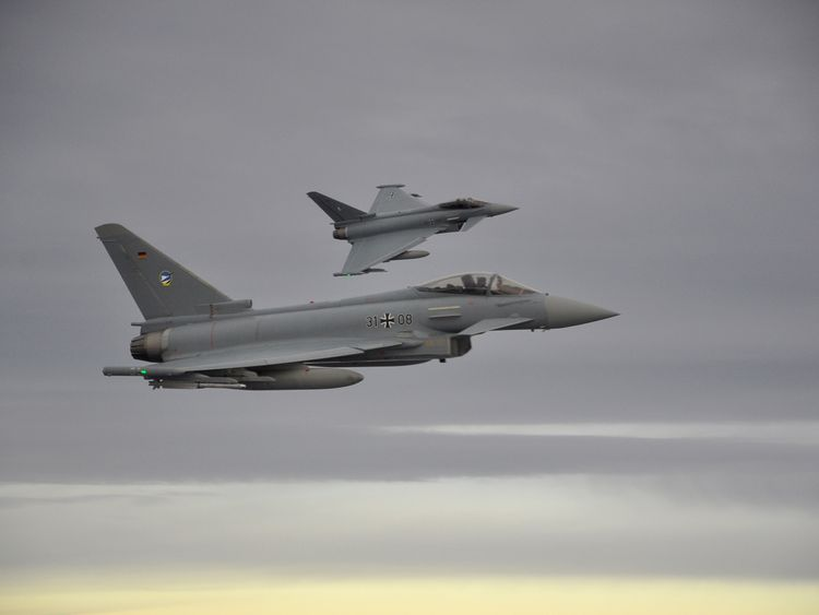 Two German Eurofighter jets simulate the interception of a plane over the Baltic sea during the drill