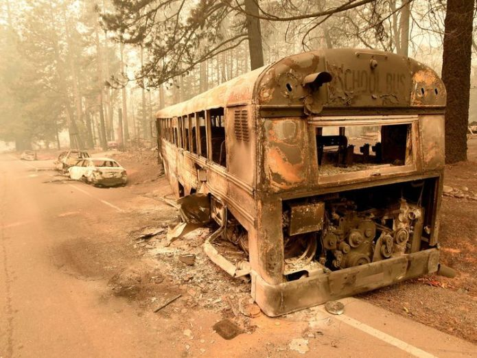 Abandoned burned-out cars and school bus sit on the side of a road in Paradise, California  At least five people killed in their cars as California wildfires spread and Malibu is evacuated skynews paradise california 4482176