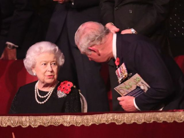 Prince Charles speaks with his mother at the concert