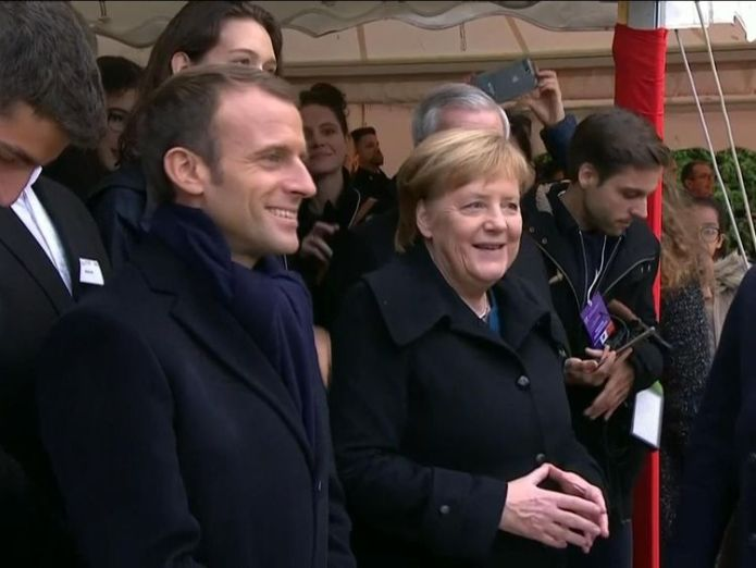 Mr Macron and Ms Merkel at a cemetery in France  President Trump criticised for missing war graves visit due to weather skynews trump macron merkel 4482688