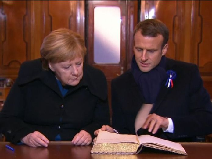 Mr Macron and Ms Merkel in the railway carriage where the Armistice was signed  President Trump criticised for missing war graves visit due to weather skynews trump macron merkel 4482691