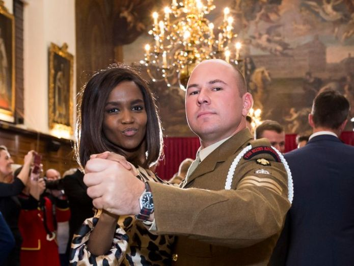 **STRICTLY EMBARGOED UNTIL 00:01 SATURDAY 10 NOV 2018** Oti Mabuse dances with a soldier from the Household Cavalry Regiment at the Royal Hospital Chelsea.  Strictly stars thank armed forces for Armistice Day skynews ww1 strictly 4480685