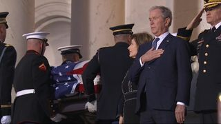 Bush watches fathers coffin pass into Capitol.