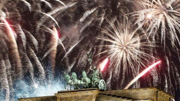 Fireworks explode over the Quadriga sculpture atop the Brandenburg gate during New Year celebrations in Berlin, Germany, January 1, 2019