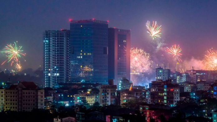 Fireworks explode over the city during New Year celebrations in Yangon on January 1, 2019. (Photo by YE AUNG THU / AFP) (Photo credit should read YE AUNG THU/AFP/Getty Images)