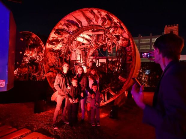 Guests pose in front of boring equipment
