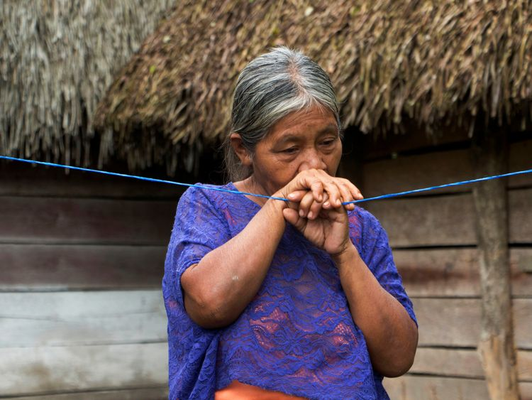 Elvira Choc, 59 grandmother of Jakelin, a 7-year-old girl who died in U.S. custody, stands outside her house in Raxruha, Guatemala December 15, 2018. REUTERS/Josue Decavele
