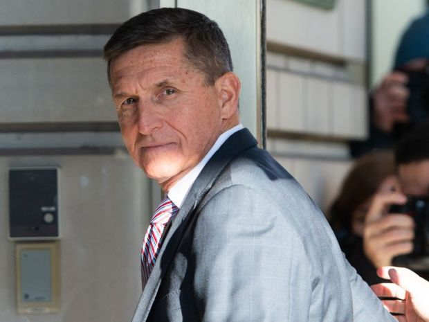 Michael Flynn arrives for his sentencing hearing at US District Court in Washington DC
