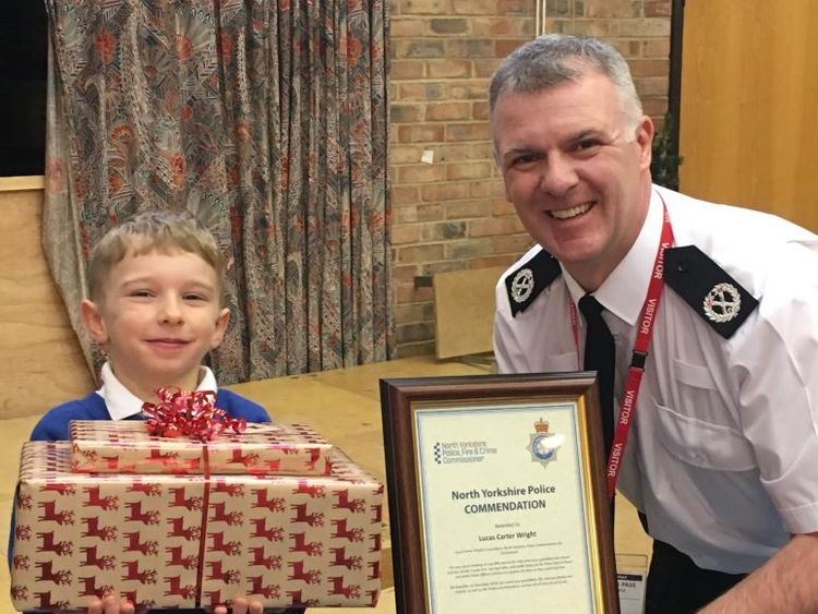 Lucas and ACC Ciaron Irvine after receiving an early Christmas present and commendation