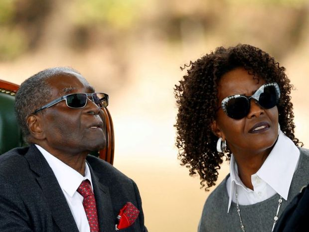 "FILE PHOTO: Zimbabwe's former president Robert Mugabe and his wife Grace look on after addressing a news conference at his private residence nicknamed ""Blue Roof"" in Harare, Zimbabwe, July 29, 2018. REUTERS/Siphiwe Sibeko/File Photo"