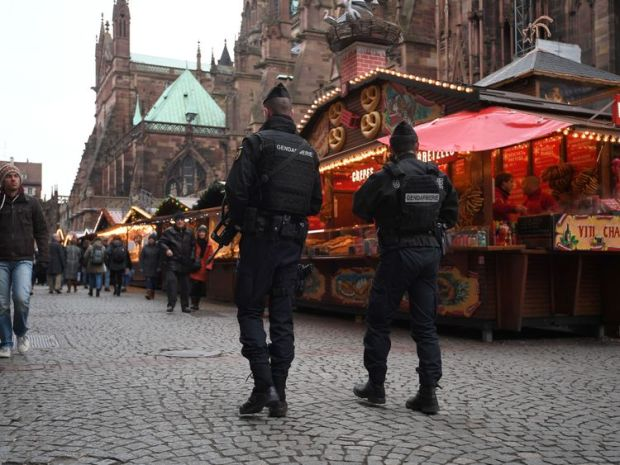 Gendarmes patrol at Strasbourg's Christmas market, on its reopening day, on December 14, 2018, one day after French police shot dead the gunman who killed four people there