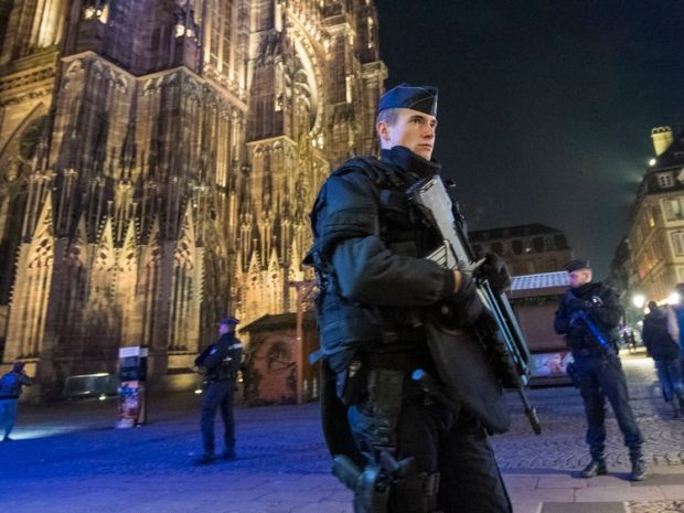 Police officers patrol in front of Strasbourg's cathedral