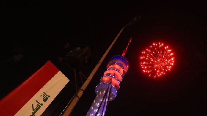 Fireworks burst above the Baghdad Tower in the Iraqi capital Baghdad on January 1, 2019 as Iraqis welcome the New Year when the tower was also opened again after its closure in 2003 during entry of US forces to Baghdad