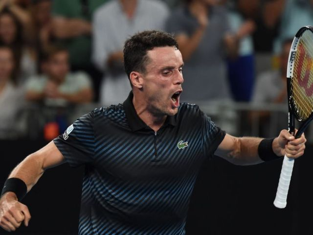 Roberto Bautista Agut celebrates after winning the first round match