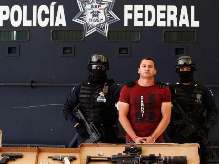 Federal police escort suspect Jose Antonio Torres Marrufo alias