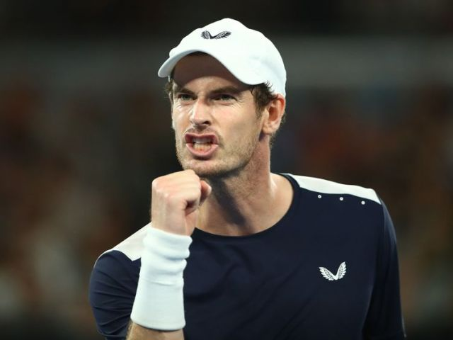 MELBOURNE, AUSTRALIA - JANUARY 14: Andy Murray of Great Britain celebrates winning a point in his first round match against Roberto Bautista Agut of Spain during day one of the 2019 Australian Open at Melbourne Park on January 14, 2019 in Melbourne, Australia. (Photo by Julian Finney/)