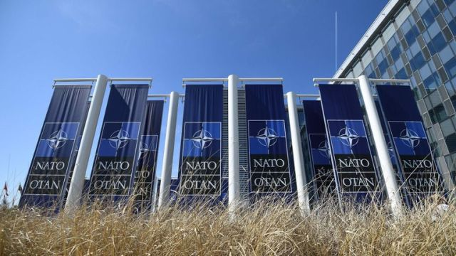 Banners with the NATO logo are pictured in front of the new NATO headquarters during a press tour of the facilities as the organization is moving from its old headquarters to the new building in Brussels on April 19, 2018. (Photo by Emmanuel DUNAND / AFP) (Photo credit should read EMMANUEL DUNAND/AFP/Getty Images)
