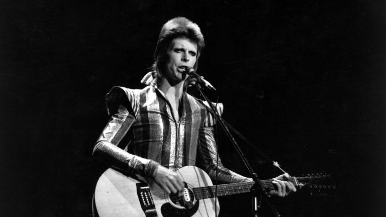 Ziggy Plays Guitar 3rd July 1973: David Bowie performs his final concert as Ziggy Stardust at the Hammersmith Odeon, London. The concert later became known as the Retirement Gig. (Photo by Express/Express/Getty Images)