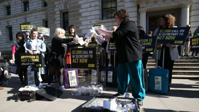 The protesters opened their suitcases outside the Northern Ireland Office