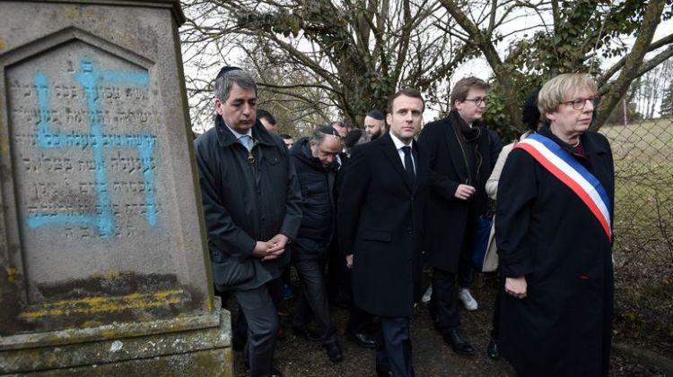 Emmanuel Macron made a sombre visit to the cemetery in Quatzenheim near Strasbourg
