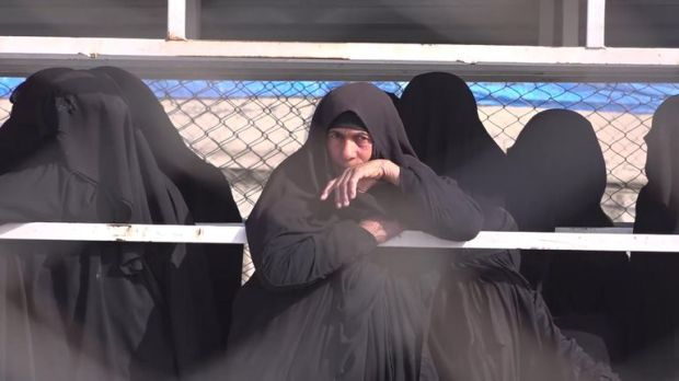 Women linked to Islamic State are held in a section of a Syrian refugee camp