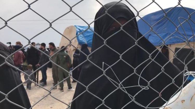 A woman from Trinidad spoke angrily about being held in the camp