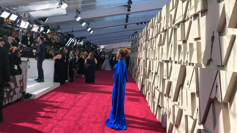 Sky News' Bethany Minelle walks down the red carpet, following the route that the celebrities walk. past the waiting press.