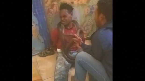 The suspect was seen wincing and writhing on the floor during the interrogation