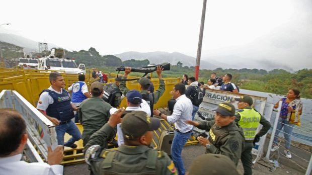 The moment two Venezuelan guards hand themselves to the Colombian authorities