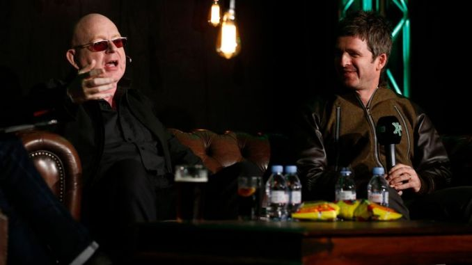 Noel Gallagher (right) speaks to Alan McGee during XFM Presents An Evening in Conversation with Noel Gallagher at Hammersmith Social Club, London, in aid of new national charity, Global's Make Some Noise, in 2014