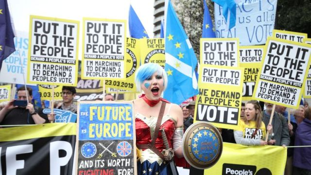 Anti-Brexit campaigners take part in the People's Vote march