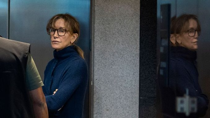 Felicity Huffman inside the Edward R Roybal Federal Building and US Courthouse in LA - Two Hollywood actresses, Huffman and Lori Loughlin, are among 50 people indicted in a nationwide university admissions scam, court records unsealed in Boston on March 12, 2019 showed