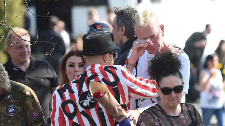 Fans of Keith Flint fill the streets of Braintree as the late singer's funeral procession makes its way to St Mary's Church in Bocking, Essex