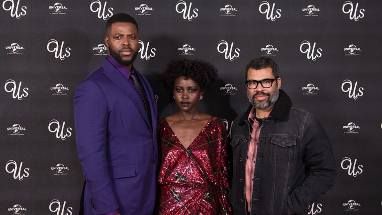 Us star Winston Duke, left, Nyong'o,  and director Jordan Peele