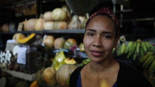 Rosa Gonzalez runs a fruit store in Caracas, Venezuela. She is giving away most of her fruit because the power cut means it does not last long.