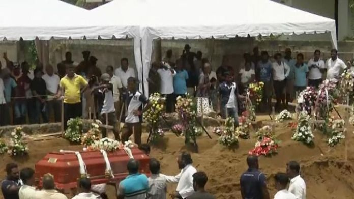In Sri Lanka mass burials are carried out after terrorist bombing raids