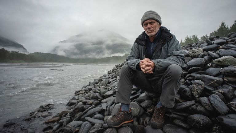 Jeremy Wade sitting on rocks by a river in Port Fidalgo, Prince William Sound, Alaska. Pic: Animal Planet