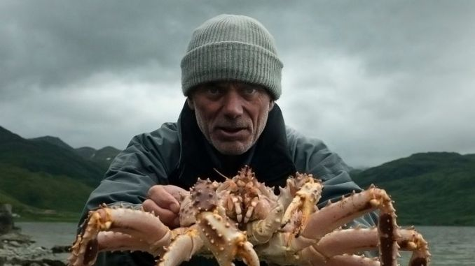 Jeremy Wade holding a spider crab in Dutch Harbor, Alaska. Pic: Animal Planet