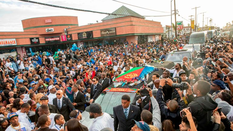 Nipsey Hussle's procession drove past his clothing store, where he was killed.